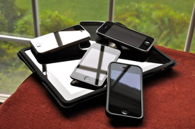 different iOS devices lying on a table